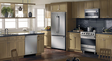 a kitchen with a full range of appliances