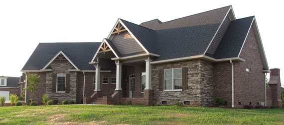great curb appeal with its mix of stone  brick and cedar shakes Builder Finds Perfect Spec Home The House Designers