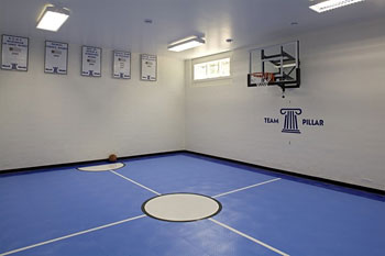 Creating a home gym in your new home the house designers for House plans with indoor sport court