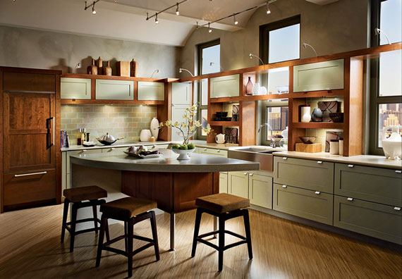 This KraftMaid ? kitchen uses the bi cabinet trend, contrasting gray