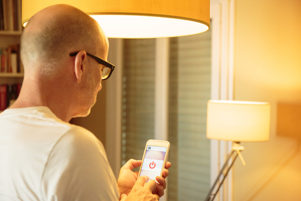 A man using an app to control LED lighting