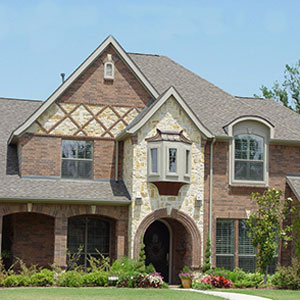 Beautiful stone veneer and brick the house designers for Beautiful brick and stone homes