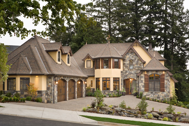 New home designs trending this 2015 the house designers for Stone and stucco home designs