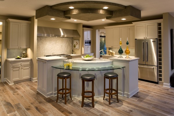 This kitchen is a chefs delight with an abundance of counter space for food  prep and Kitchen Lighting Design Ideas The House Designers