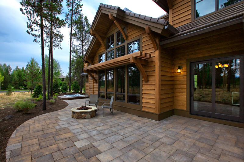 Four bedroom craftsman house plan for Patio home plans with rear garage