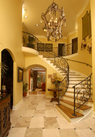 Designing the right stairway the house designers for House plans with stairs in foyer